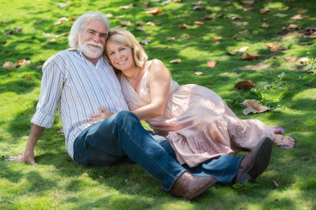 Old people and romance, elderly husband and wife in love, lying on grass in park Stock Photo - 14508404