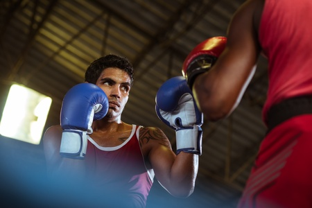 ring stand: Sport and people, two men exercising and fighting in boxing gym Stock Photo