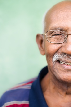 Seniors and feelings, elderly black man with glasses and mustache smiling.