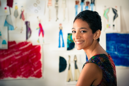 atelier: Confident entrepreneur, portrait of happy hispanic young woman working as fashion designer and dressmaker in atelier