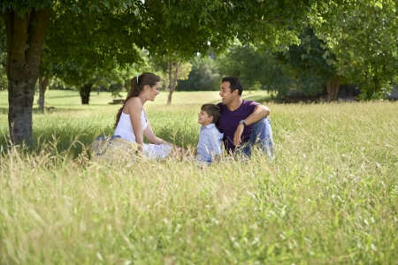 People and recreation, happy boy spending time with parents, playing in park with mother and father. Full length photo