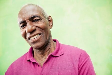 Old people and emotions, portrait of senior african american man looking and smiling at camera. Copy space photo