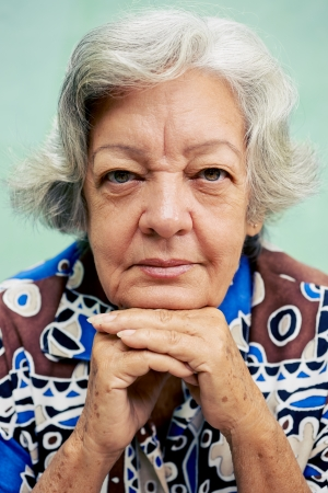 Senior people portrait, happy old woman smiling and looking at camera Stock Photo