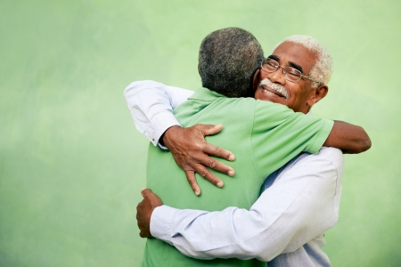 friend hug: Active retired old men and leisure, two senior black brothers hugging outdoors