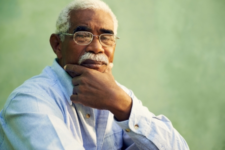 Black people and emotions, portrait of depressed senior man with glasses looking at camera. Copy space photo