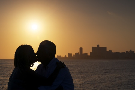 Silhouette of couple and skyline of the city photo