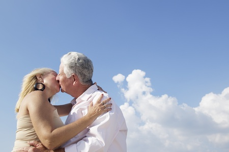 Elderly couple in love, honeymoon with old man and woman kissing. Copy space photo