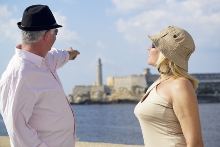 Tourism and active retirement with elderly people traveling, senior couple having fun on holidays in Havana, Cuba photo