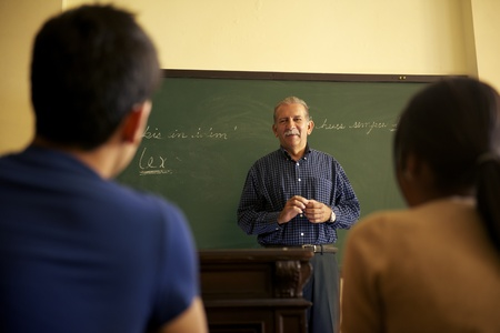 class room: People and education, professor talking to students during lesson in college, Law School, University of Havana, Cuba Stock Photo