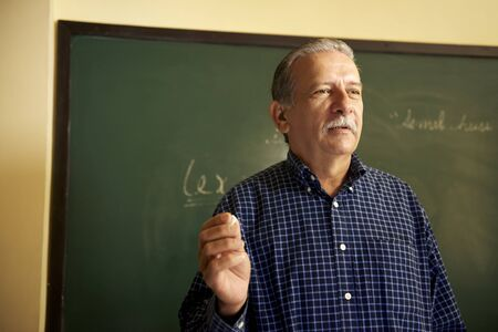 professor talking to students during lesson in college photo