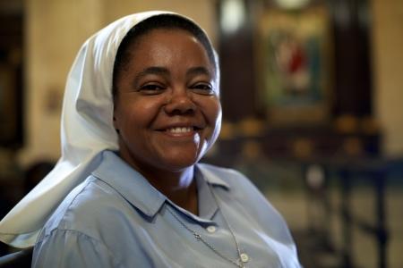 nun: portrait of catholic nun praying in church