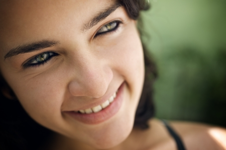 Pretty girl with green eyes, portrait of happy young hispanic woman looking at camera and smiling. Sequence photo