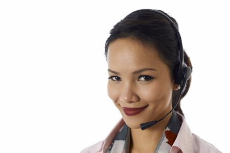 Young people, work and technology, portrait of happy Asian girl working as call center operator with headset, customer care representative, smiling at camera photo
