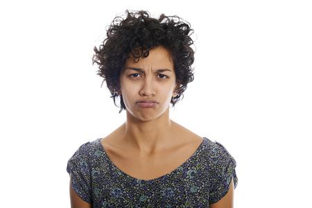 portrait of hispanic woman looking at camera upset and sad. Isolated on white background