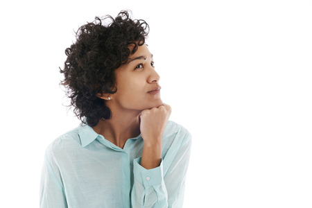 embarassment: Portrait of confused and uncertain hispanic business woman on white background Stock Photo