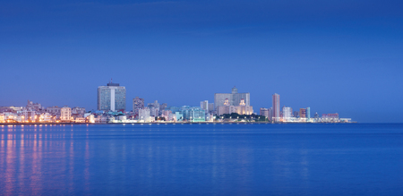 habana: Tourism and travel destinations. Cuba, Caribbean sea, La Habana, Havana. View of skyline and buildings from malecon. Copy space
