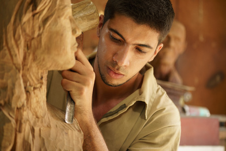 chisel: Man, people, job, young student at work learning craftsman profession in art class, working with wooden statue and carving wood
