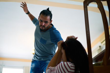young wife: Social issues, abuse and aggression on women, young drunk man hitting and beating woman at home after drinking alcohol. Violent husband fighting with abused wife