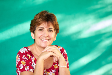 Cuban people and emotions, portrait of latina lady laughing and looking at camera. Happy hispanic woman from Havana, Cuba smiling Stockfoto