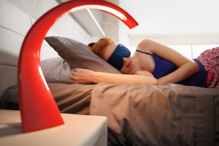 Woman In Bed Sleeping With Sleep Mask On Eyes