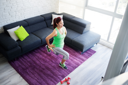 Fitness And Wellbeing With Elderly Woman Training Practicing At Home Stockfoto