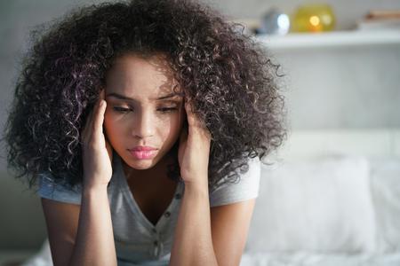 Depressed Hispanic Girl With Sad Emotions And Feelings