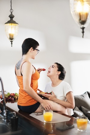 Love Affection Flirt For Lesbian Couple Eating Breakfast At Home Stockfoto