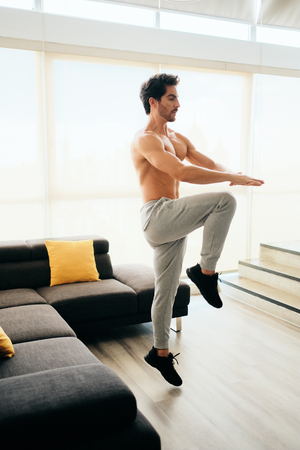 Adult Man Training ABS and Legs Doing High Knee Tap