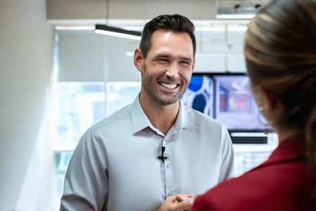 Business Man In Office Talking And Smiling During Corporate Interview