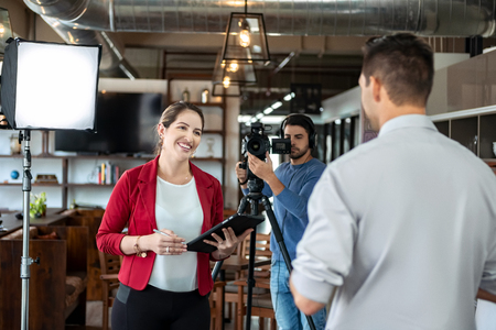Journalist Interviewing Business Man In Conference Room For Broadcast Banco de Imagens