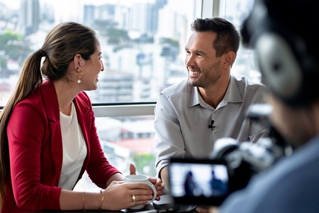 Business Man In Office Talking And Smiling During Corporate Interview Stock Photo