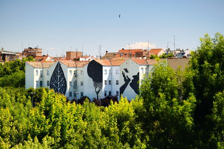 Graffiti and Paintings on House Buildings Near Puente de Toledo in Madrid
