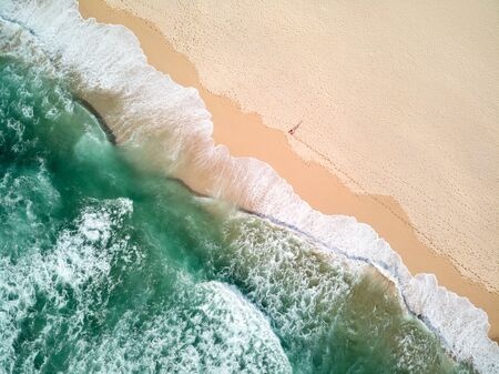 Aerial Photography of Ocean With Person Walking on Beach