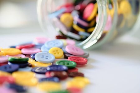 Large Group Of Colorful Plastic Sewing Buttons In A Can On Table, With Copy Space For Text Фото со стока