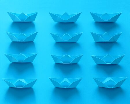 Close Up Real Origami Boats On Blue Background Фото со стока