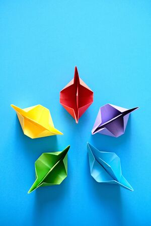 Authentic Origami Boats In Circle On Blue Background Фото со стока