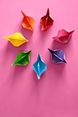 Authentic Origami Boats In Circle On Pink Background Фото со стока