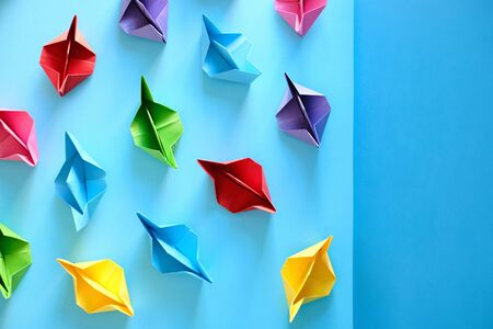 Fleet Of Authentic Origami Boats On Blue Background Фото со стока