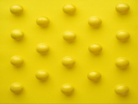 Pattern Of Chicken Eggs In Line Against Yellow Background Фото со стока