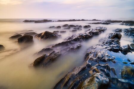 Long Exposure Photography Of Dreamy Seascape In Portugal With Sea And Waves At Sunset