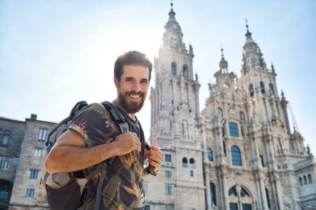 Portrait Of Happy Man On Pilgrimage At Santiago De Compostela Фото со стока - 141037377