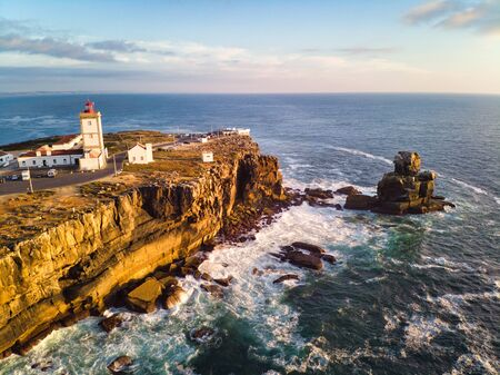 View Of Lighthouse And Sea In Peniche Portugal At Sunset Фото со стока - 142018479