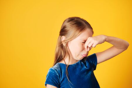 Little Redhead Girl Covering Nose For Bad Smell 版權商用圖片