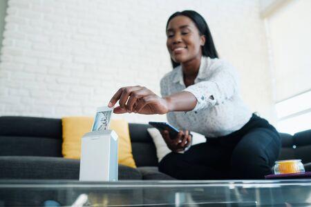 Black Woman Using Portable Printer For Printing Pictures Archivio Fotografico