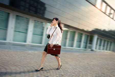 Mature Woman Arriving Late To Office Walking Fast On Street
