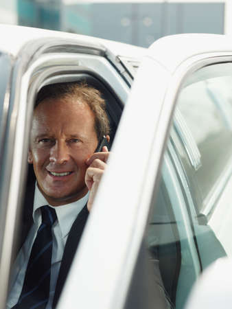 Man Working As Driver Of Limousine Answering Phone Call