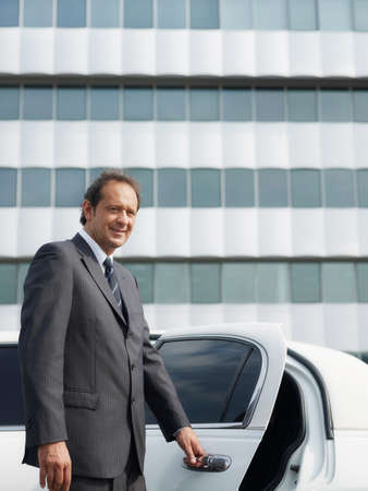 Portrait Of Man Working As Driver In White Limousine