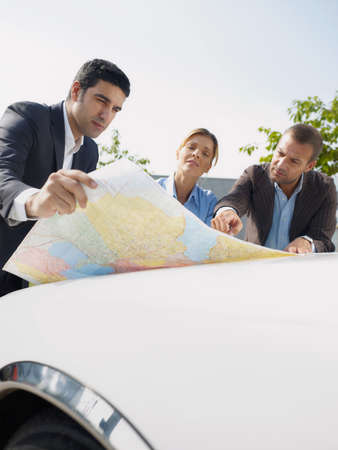 Business People Planning Car Trip Consulting Map For Directions Фото со стока