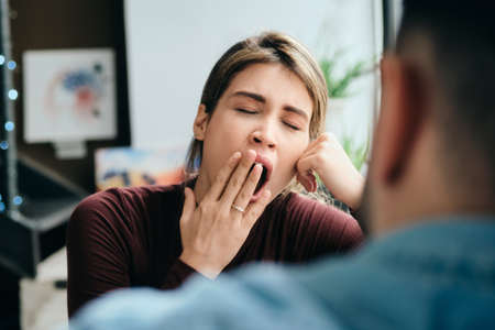 Woman Yawning During Boring Conversation With Partner