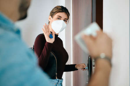 Woman Wearing N95 Mask Before Going Outside Фото со стока